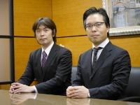 写真●田島総合法律事務所の田島正広弁護士(右)と河盛史郎事務局業務部長